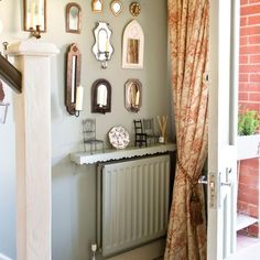 Eclectic hallway with mirrored wall