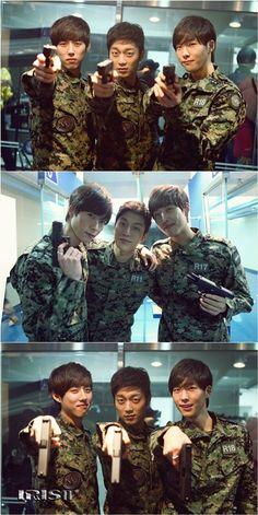Doojoon, Lee Seung Hak, and Baek Sung Hyun practice their aim on 'IRIS 2′