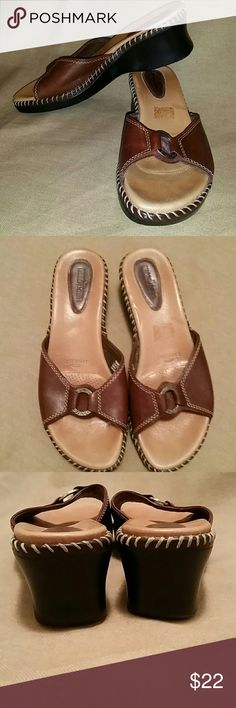 Minnetonka sandals EUC Liquicell.  leather upper Awesome shoes.  no scuffs.  2 inch heel.   brown leather upper.  ring on front is silver.  contrast stitching around edge.  black bottom. Minnetonka Shoes Sandals