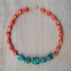 Coucou Suzette ethnic inspired jewelry This is a colorful Tibetan inspired handcrafted necklace, with a modern touch. The materials are coral nuggets, brass , and turquoise magnesite