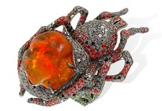 """LydiaCourteille """"spider"""" ring featuring a gorgeous fire opal, orange sapphires, diamonds, green garnets and blackened gold from the """"Xochimilco Garden"""" collection."""