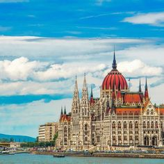 Budapest, Hungary....   View of Parliament and Pest on the Danube. The Parliament is an iconic symbol of the city and it's definitely a one-of-a-kind masterpiece.    #budapest#hungary#danube#river#travel#amazing#beautiful#city#europe#ig_captures#colorful#photography#beautifuldestinations#cityscape