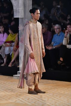 Tarun Tahiliani ICW 2018 collection has phenomenal red bridal lehengas along with fusion wear sarees. Also see under lakh Tarun Tahiliani Lehengas. Wedding Outfits For Groom, Indian Wedding Outfits, Indian Outfits, Wedding Couples, Wedding Ideas, Latest Bridal Lehenga Designs, Indian Men Fashion, Groom Fashion, Men's Fashion