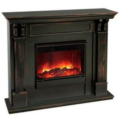 electric hearth fireplace in the bedroom for romance. remote control of course