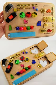 Sensory busy board with two doors, magnets, velcro, colored balls and other fun elements!