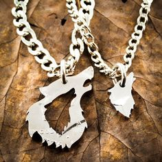 These wolf necklaces are cut by hand from the same coin. The double wolf design is sweet and shows your special someone that you care.  With your order you get two very good quality stainless steel necklaces with each set. Or, if you choose, we put one or both on keychains  If you like our work please check out our facebook. We regularly put news and new designs there and we answer questions about our work and all sorts of design possibilities.. http://www.facebook.com/namecoin...