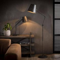 This Aris floor lamp has a round conical hood with three adjustable points at the hood and halfway the leg, making it possible to bend the hood and the leg. The Aris floor lamp is made of metal with a dark 'charcoal' color. Industrial Floor Lamps, Industrial Bedroom, Desk Lamp, Table Lamp, Home Pub, Led Röhren, Affordable Furniture, Bedroom Themes, Office Interiors