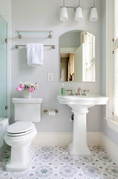 Want a half bathroom that will impress your visitors when entertaining? Update your bathroom design in no time with these budget friendly, adorable half bathroom ideas. Pedestal Sink Bathroom, Bathroom Floor Tiles, Downstairs Bathroom, Small Bathroom, Bungalow Bathroom, Bathroom Wallpaper How To, Bathroom Ideas, Tile Floor, Rental Bathroom