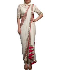 This off-white embellished blouse with mirror and pearl embroidery, matching thick lace fitted pants with mirror embellishment and self stripe saree drape with mirror border.