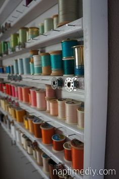 Sewing studio ingenious thread holder that keeps the bobbins below the thread with a bonus trick for keeping the bobbins from unwinding