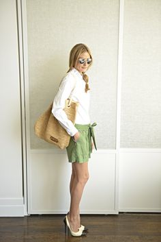 Olivia Palermo - 30 Looks for 30 Days - Day 6 - Today I am wearing Dior sunglasses, an Ann Taylor shirt, Elizabeth  James shorts. Jimmy Choo shoes, and a Seafolly bag.