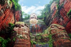 Giant Buddha, Leshan, China  Was built during the Tang Dynasty (618–907AD). It is carved out of a cliff face that lies at the confluence of the Minjiang, Dadu and Qingyi rivers  near the city of Leshan. The stone sculpture faces Mount Emei, with the rivers flowing below his feet. It is the largest stone Buddha in the world[1] and it is by far the tallest pre-modern statue in the world. http://en.wikipedia.org/wiki/Leshan_Giant_Buddha