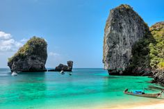 The Phi Phi Islands (Mu Ko Phiphi,) are in Thailand, between the large island of Phuket and the west Strait of Malacca coast of the mainland. The islands are administratively part. Phi Phi Island, Phuket, Bangkok Krabi, Île Phi Phi, Thailand Travel Packages, Destinations, Destination Voyage, Backpacking Europe, Destin Beach