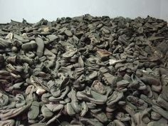 These are the shoes that remained after jewish people in the concentration camps were sent to the showers/gas  chambers were they were killded. It shows how many people were killed.