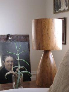 Wood block or branch with a wood veneer shade? Or raffia macrame?