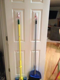 solution for my broom and mop. Attached them with command hooks and ribbon. Home Decor Hooks, Dorm Room Organization, Organization Ideas, Command Hooks, Command Strips, Diy Home, Home Hacks, Getting Organized, Living Room Designs