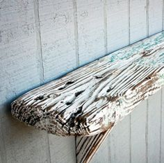 Use pieces of wood we find on the beach to make shelves