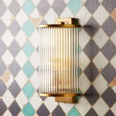 Art Deco in feel this roddy wall light is a neat semicircular wall sconce bordered by twenty glass rods, that let the light sparkle through. Art Deco Wall Lights, Glass Wall Lights, Bathroom Wall Lights, Led Pendant Lights, Wall Sconces, Bathroom Lighting, Bathroom Lamps, Vanity Lighting, Bauhaus