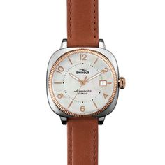 The Gomelsky 36mm pink leather watch with white face is an American-made timepiece that features a wide-eyed case, coin-edge bezel and a Swiss quality quartz Argonite 715 movement, which is assembled in Detroit from nearly four-dozen Swiss made parts.