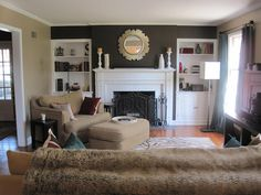 Over sized chair beside the fireplace & brown zebra rug..XoXo