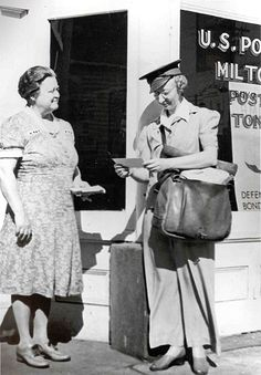 Woman working as Letter carrier to free up men for the war. Women waiting for news from their husbands and sons and sweethearts.