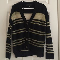 Gold and Black Mesh Cardigan A pretty cardigan from forever 21! The black part is knit and the gold parts are a mesh/chain link material. There is a small part at the bottom button where the seam came undone but isn't noticeable when it's being worn and can easily be fixed! Forever 21 Sweaters Cardigans