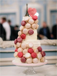 Wedding cake adorned with macaroons for a French themed wedding  #PPEvents #FrenchInspired
