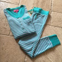 """Victoria's Secret 2 Piece Thermal PJ Set Victoria's Secret 2 Piece Thermal PJ Set. Size XS. Aqua and pink with metallic stripe. Top has long sleeves, button front and pocket. Bottoms have elastic and drawstring waistband, back pocket and 29"""" inseam. 92% cotton/4% spandex/4% other. EXCELLENT CONDITION-LIKE NEW!!! No trades Victoria's Secret Intimates & Sleepwear Pajamas"""