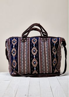 Beautifully beaded, perfect size weekender tote bag with suede bottom, trim and zippered closure. Self: 90% Cotton, 10% Leather Lining: 100% Polyester Three inner pockets. Size: W: 58cm x H: 39cm