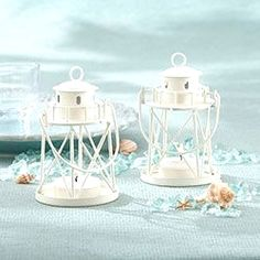 Lighthouse tea light holders add the glow of candle light to destination weddings and sea side parties. This nautical favor is a Summer favorite. As a beautiful, beach-themed wedding favor, this lighthouse tea light holder shines! Nautical Wedding Favors, Elegant Wedding Favors, Candle Wedding Favors, Candle Favors, Wedding Favors For Guests, Wedding Favors Cheap, Wedding Invitations, Beach Themed Wedding Cakes, Beach Centerpiece Wedding