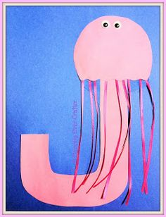 Jellyfish J - We used Dessert Plates cut in half (wavy at the bottom) and painted pastel colors, and several colors of curling ribbon for the tentacles; eyes optional as you can't see them on real jellies