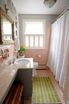 Sink extended over the tank of a small bathroom, I'd do this in sea glass colors. These are remodel bathroom design ideas. The designs are modern, simple, classic and luxurious. Pink Bathroom Tiles, Rustic Bathroom Shower, Peach Bathroom, Eclectic Bathroom, Simple Bathroom, Bathroom Shower Curtains, Bathroom Ideas, Downstairs Bathroom, Bathroom Colors