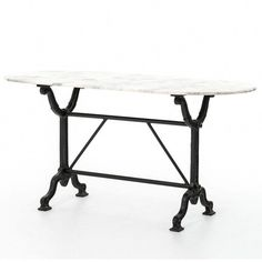 Ava Writing Table from the Rockwell Collection from Four Hands Art and functionality fuse in the 'upcycled' furnishings, utilizing a variety of refurbished materials. The Khazana is a furniture store located in Austin, Texas.