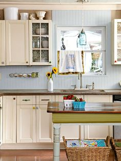 Love the little pops of color and glass doors on some cabinets