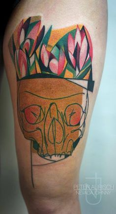 Skull and tulips tattoo by Peter Aurisch. I'm not typically into skull tattoos, but this one is pretty fantastic!