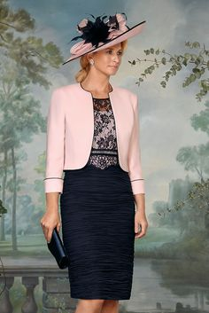 70830 (Condici) Ruched Georgina dress with crepe jacket in Flamingo/Navy and Seaspray/Navy. The dress has a lace overlay bodice with diamante belt and lace sleeves. The skirt is ruched and is knee length. The matching jacket is Crepe with a Read More...
