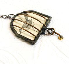 Birdcage Necklace, Birdcage Shadowbox Pendant, Soldered Glass Birdcage, Vintage Postcard Pendant, Vintage Bead Chain and Rosary Assemblage. $40.00, via Etsy.