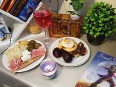 A small launch party I held for Sand Dancer's release on July 1st 2019 with a selection of Sand Dancer inspired food! Including cinnamon buns, figs, dates, flatbread, goats cheese, ham, and falafel.