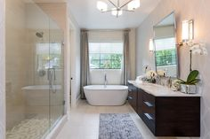Similar inverse layout with enclosed shower, bathtub under window & floating vanity sink