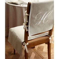 Hmmmmm. placemats, ribbon and glue for the top?    Products No Sew Chair Slipcovers