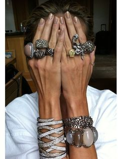 stacked jewellery in taupe and pale grey with nails to match