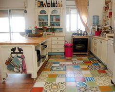 Happiest little cottage-ish kitchen, mismatched tiles on floor. wonderful.