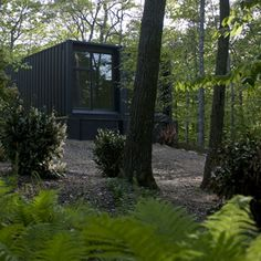 Art studio in the woods made of two steel shipping containers in Amagansett, New York.