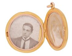 A locket containing two photographs, one of his wife and the other of their daughter, belonging to Edward Herbert Keeping, a personal valet who died on the Titanic, is pictured in this undated handout image received by Reuters March 26, 2012. The locket was officially recorded by the provincial coroner of Nova Scotia before it was returned to his wife, and is contained in the record of bodies and effects: passengers and crew of S.S. Titanic (Body No. 45), public archives of Nova Scotia.