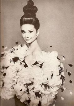Audrey Hepburn in Saint Laurent's giant puff of organdie and feather flowered fluttering hug photographed by Richard Avedon
