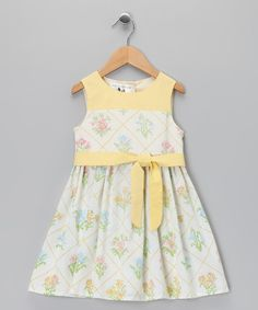 Crafted from environmentally friendly upcycled materials, this heirloom-quality cotton dress features timeless detailing, a bow-tie waist and buttons up the back.100% cottonMachine wash; hang dryMade in the USA