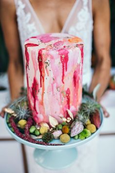 pink painted wedding cake - photo by Ivy Road Photography http://ruffledblog.com/palm-springs-inspired-wedding-editorial-from-australia