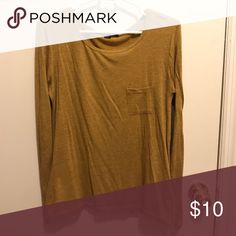 Forever 21 Mustard Yellow Pocket Tee Forever 21 Mustard Yellow Pocket Tee. Small Pocket Detail. Heather Mustard color. Only worn twice. Perfect for a 70s color palette. Forever 21 Tops Tees - Long Sleeve