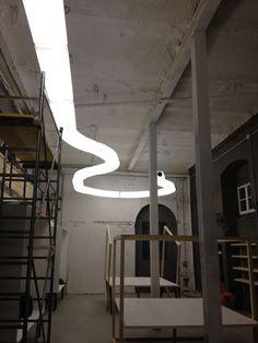 Il paretra si veste con le bellissime luci di Martinelli Luce