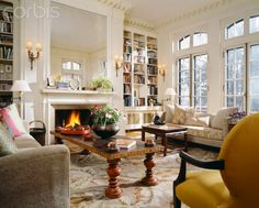 White living room with mirror over fireplace